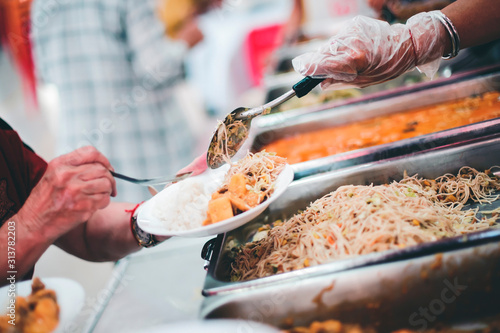 Fotomural Volunteers provide free food to the underprivileged: sharing food with humans in
