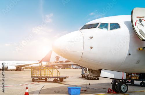 Airport runway apron and passenger aircraft Canvas Print