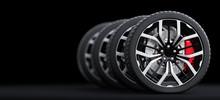 Set Of Wheels With Modern Alu Rims On Black Background