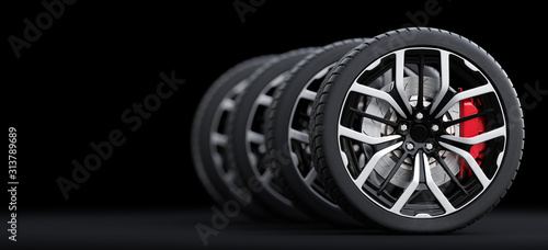 Fotografía Set of wheels with modern alu rims on black background