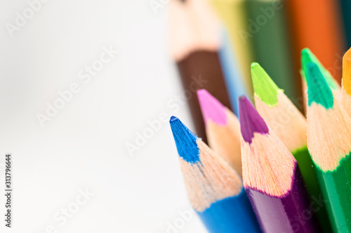 Photo Selective focus on multi colored pencils