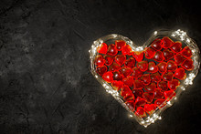 Valentine's Day - Heart Of A Garland With Lights And Red Hearts Inside On A Dark Background, Place For Text, Postcard For The Holiday