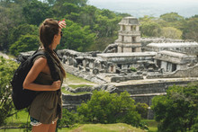 Woman With A Backpack Beside Ancient Mayan Ruins