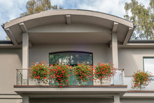 Balcony Decorated With Pots Of Geraniums