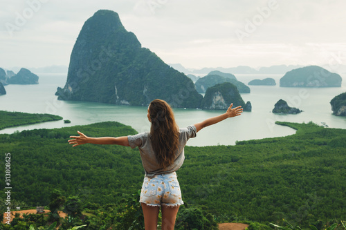 Young woman looking at the beautiful landscape