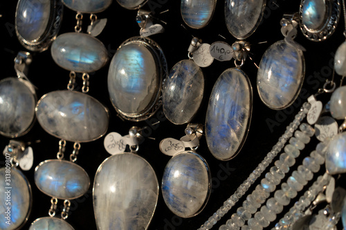 Photo Rainbow moonstone necklage earrings jewelry on display stand in a shop market