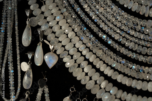 Rainbow moonstone necklage earrings jewelry on display stand in a shop market Canvas-taulu