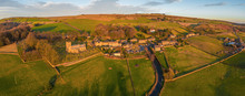 Aerial Panorama Shot Of The Village Of Bradfield In The Peak District National Park, English Countryside During A Beautiful Winter Sunset