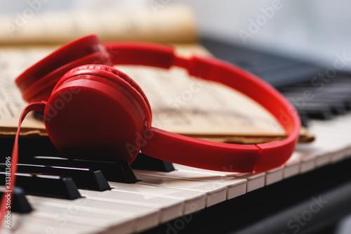 Fényképezés Red headphones over synthesizer keyboard