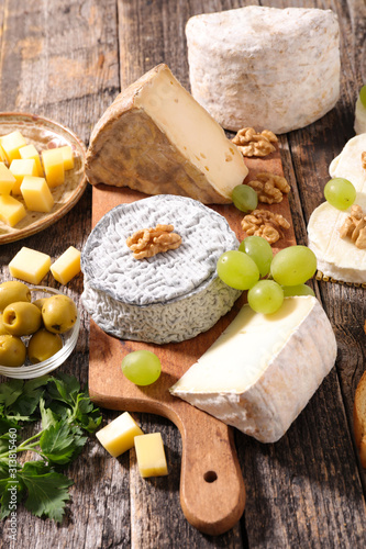 assorted of dairy products, cheese, grapes and bread Wallpaper Mural