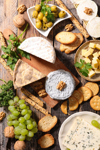 assorted of dairy products, cheese, grapes and bread Canvas Print
