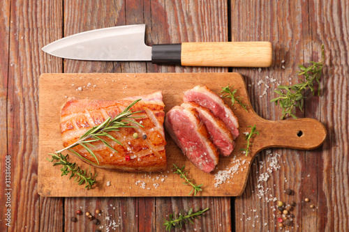 fried duck breast with rosemary on wooden board Canvas Print