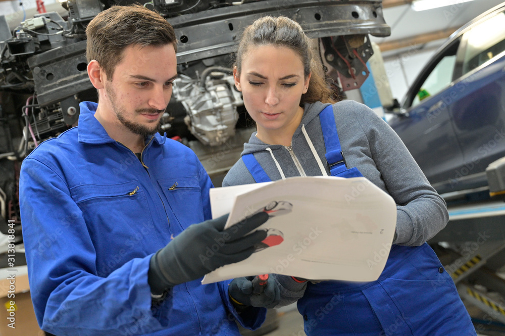 Fototapeta Young people in car industry training