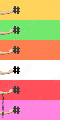 Fototapeta Social media concept. closeup of human hand holding and showing large big black hashtag sign. indoor studio shot, isolated on different colorful background copyspace. marketing symbol. obraz