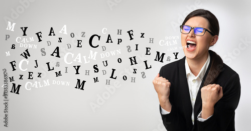 Angry businesswoman screaming, alphabet letters coming out of open mouth Wallpaper Mural