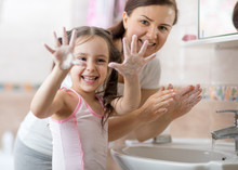 Cheerful Kid Washing Hands And...