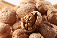 Pile Of Walnuts On White Backg...