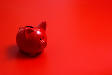 Red Piggy Bank On A Red Background