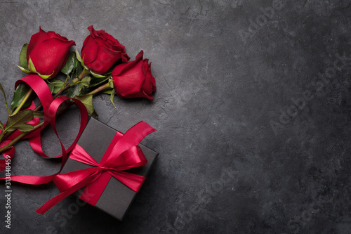 Valentines day card with gift box and rose flowers - 313848459