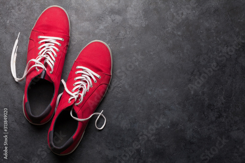 Pair of red sneakers over stone Fototapeta