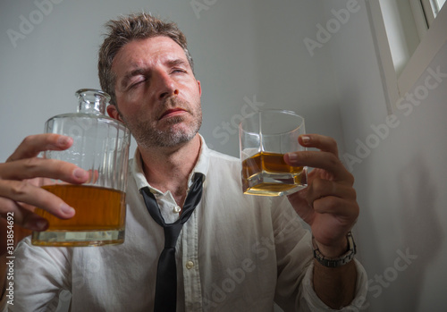 portrait of 30s to 40s alcoholic  man in lose necktie drinking desperate holding Billede på lærred