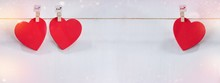 Three Red Hearts Set On String Over White Background. Valentine's Day Concept. Space For Text