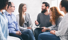 Therapist Talking With Patients During Support Group Session