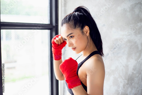 Fotografie, Tablou Amateur Kickboxers Training On Heavy Bags stock photo