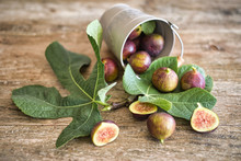 Fig Fruits And Fig Leaves On W...