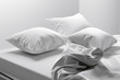 canvas print picture - Unmade bed with soft clean white linen and pillows