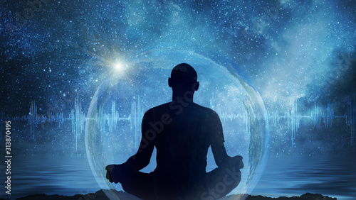 Yoga cosmic space meditation illustration, silhouette of man practicing outdoors at night - 313870495