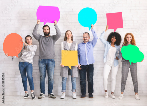 Fototapeta Group of diverse friends holding blank colorful speech bubbles obraz