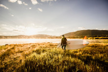 A Female Paddlboarder On Lake ...