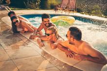 Friends Having Fun At The Pool