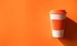 Leinwanddruck Bild - Orange reuseble cup.
