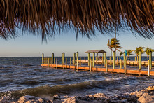 View From The Tiki Hut Of The Dock And Fishing Pier On A Windy Sunny Day In Key Largo, Florida