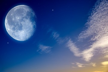 Starry sky with half moon in scenic cloudscape .