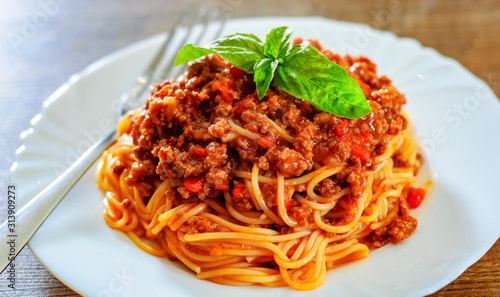 Traditional pasta spaghetti bolognese in white plate on wooden table background Obraz na płótnie