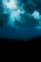 Underwater Shot Of A Wave Breaking In Fiji, Looking Like A Storm Sky