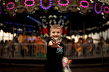 BOY AT THE CARNIVAL WITH STICK...