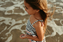 Girl Standing In Ocean With Shells Close Up Corpus Christi Texas