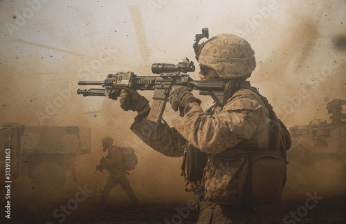 Fototapeta Military troops and machines on the way to the battlefield in desert. obraz