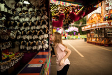 GIRL PLAYING GAMES AT THE CARNIVAL