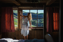 Woman Looking Out Of Cabin Win...