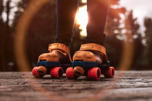 Roller Skating Child Playing Outdoors With Vintage Toy Roller Skates