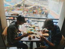 Two Young Men Eating Colorful ...