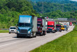 canvas print picture - Blue Semi climbs Interstate Hill In Heavy Traffic