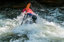 Man Kayaking In Whitewater
