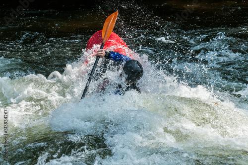 Fototapeta  man kayaking in whitewater