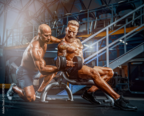 Fotografie, Tablou Bodybuilding Hardcore. Two Bodybuilders Train Together at the Gym